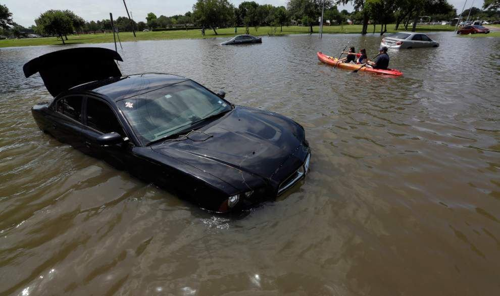 Photos: Torrential Houston rain turns interstates into rivers, floods cars, strands motorists _lowres