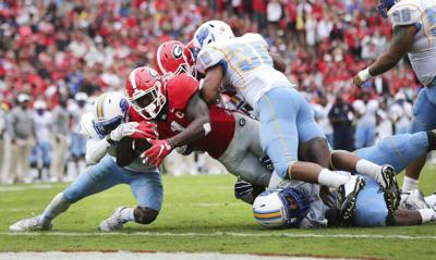 For one half, at least, Southern's defense holds down the Georgia ground game _lowres