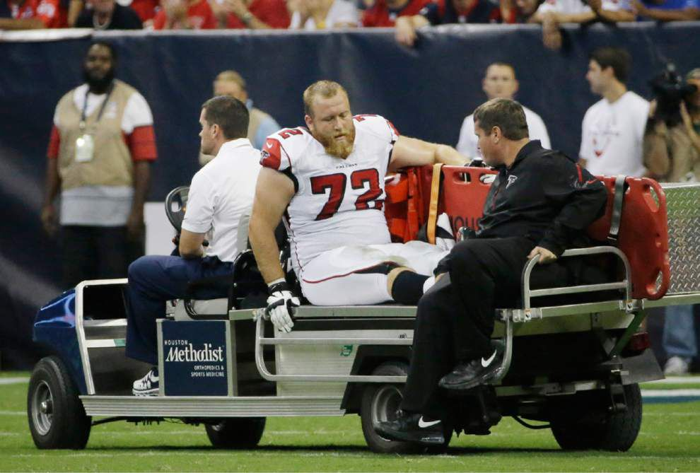 Falcons left tackle Sam Baker lost for season with knee injury _lowres