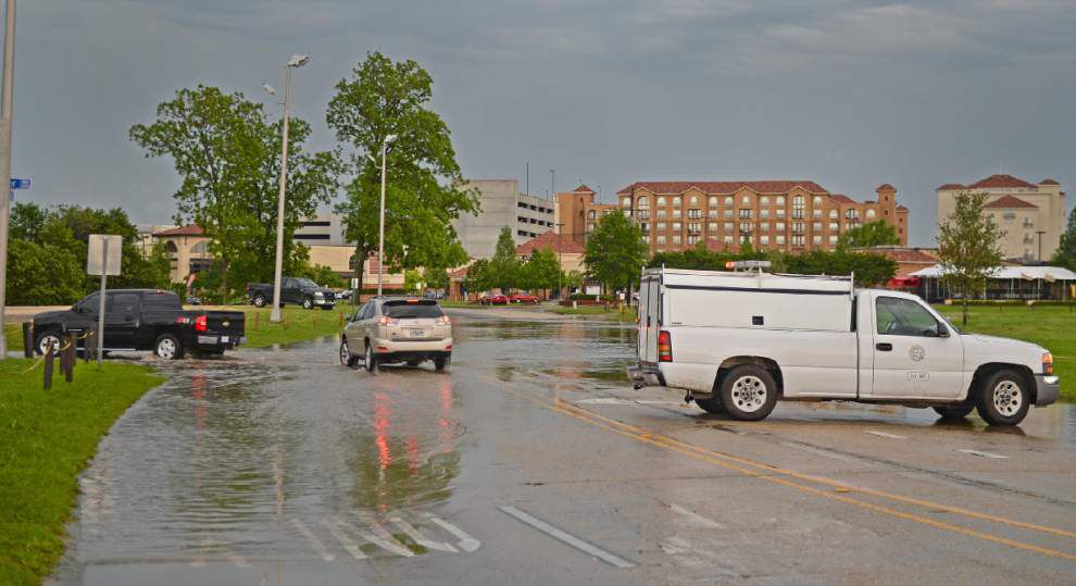 Traffic navigates a flooded Burbank Drive near LSU's campus _lowres