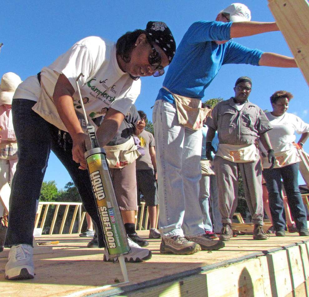 Mom and son thankful for a new home after churches come together for build _lowres