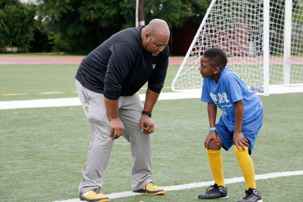Deuce McAllister and others present Cheer and Football Clinic at Harrell Playground _lowres