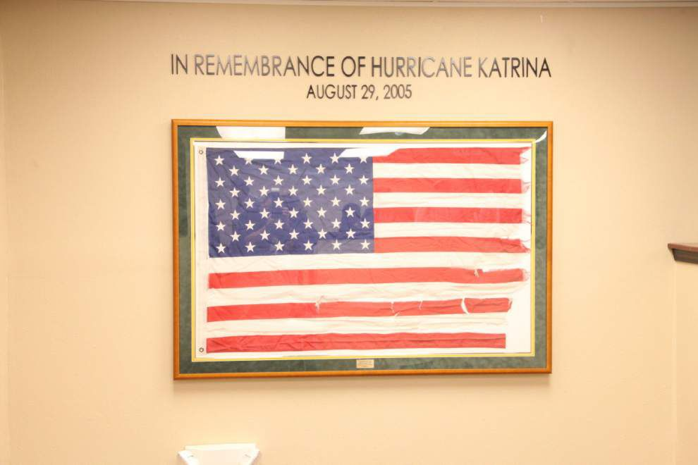 Tattered flag that flew outside Kenner home during Katrina to serve as reminder of city emergency operations center's importance _lowres