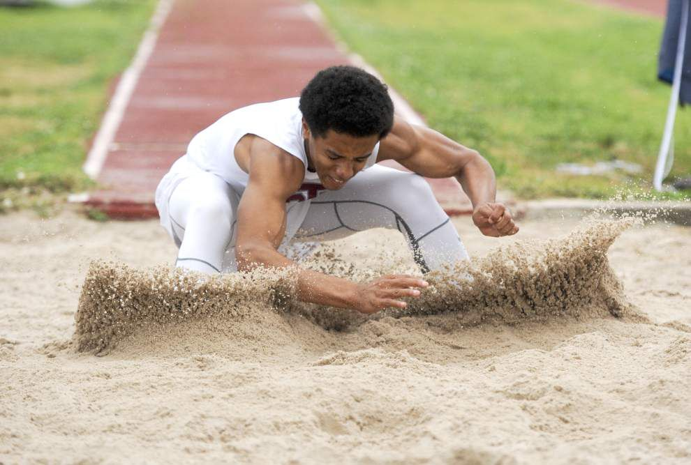 Some field events held at Oil City Relays before track meet is washed out _lowres