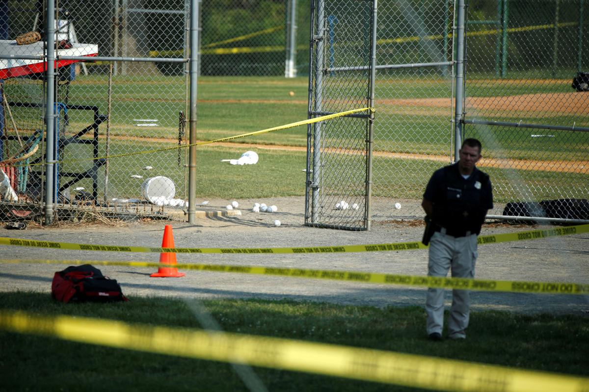 A police officer mans a shooting scene after a gunman opened fire on Republican members of Congress during a baseball practice in Alexandria, Virginia