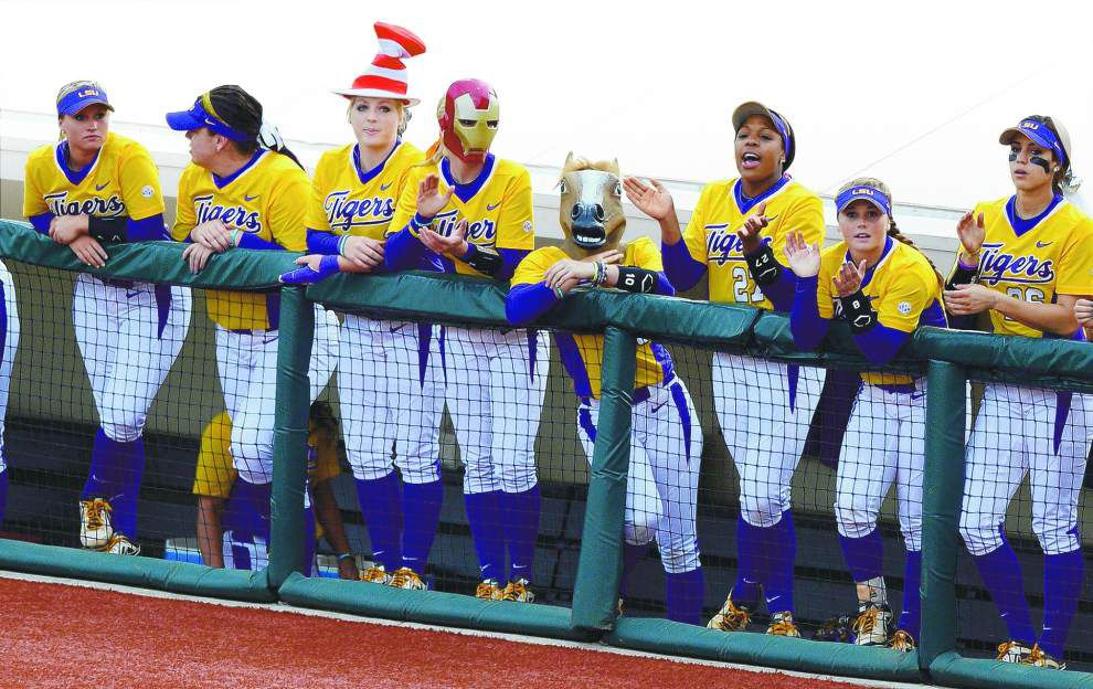 LSU takes its dugout circus — hats, masks and Tigers, oh my — to the Women's College World Series _lowres