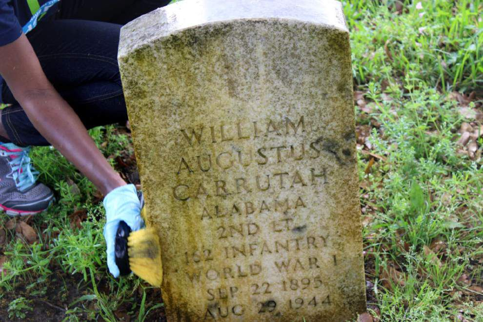 Volunteers restore graves of Union soldiers at historic Chalmette National Cemetery _lowres