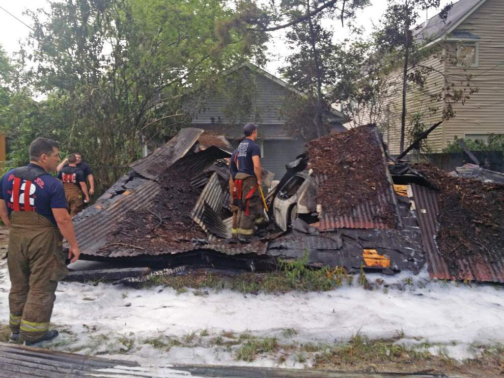 Two children detained in carport, car arson on Tulip Street _lowres