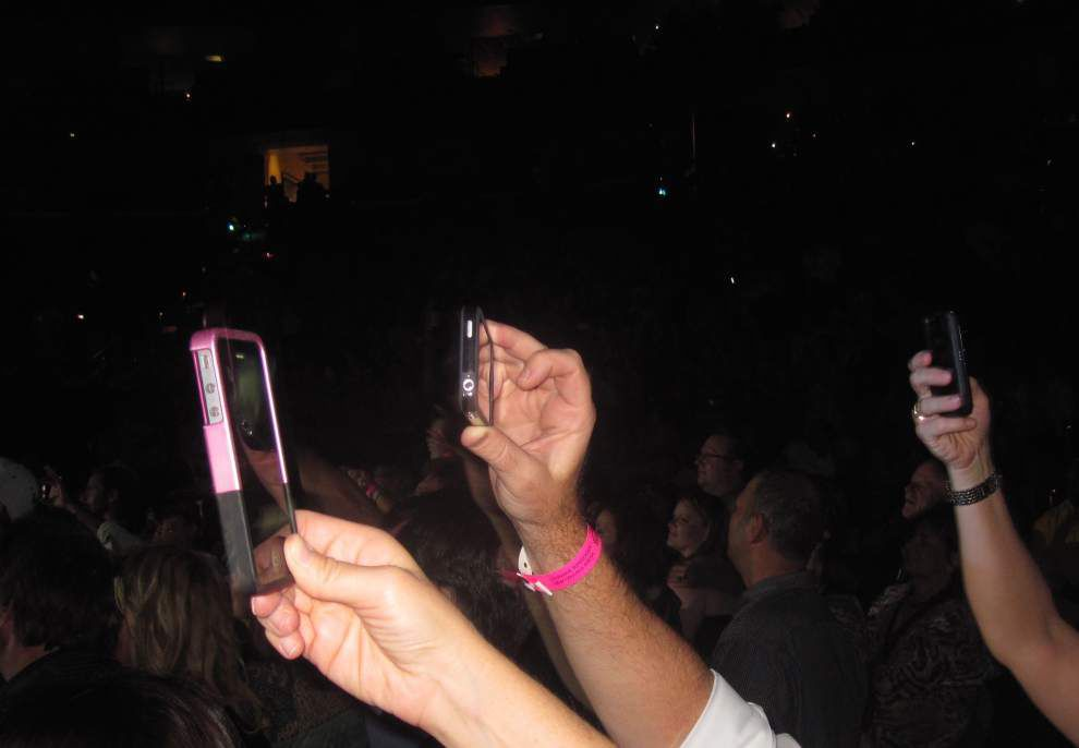 Answering questions about new trend: Why do concert-goers record with their phones? How does it affect musicians? _lowres
