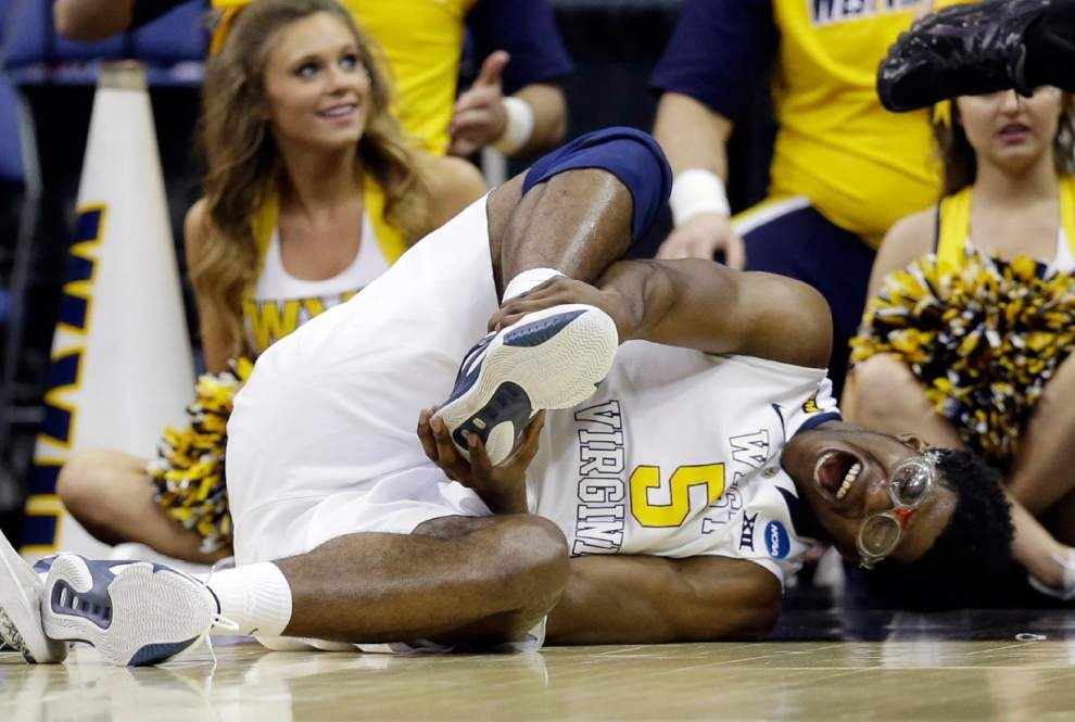 Tarik Phillip's clutch 3-pointer lifts West Virginia past Buffalo _lowres