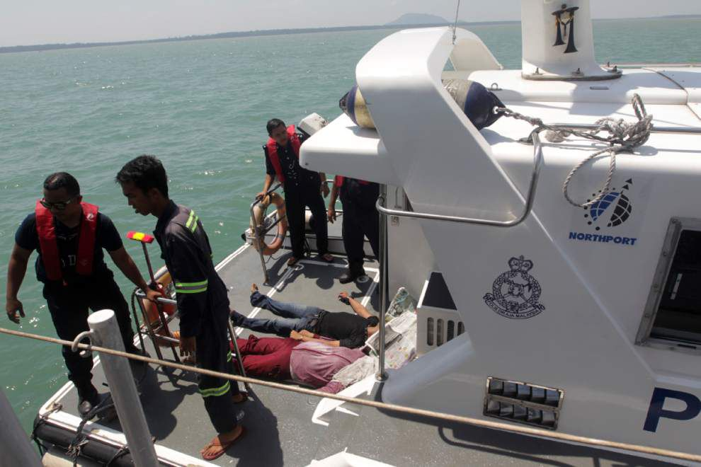 32 missing as boat sinks off Malaysia; 60 survive _lowres