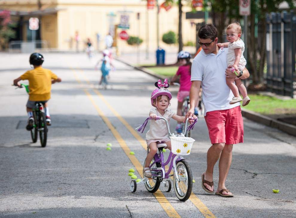 Acadiana cyclists get free helmets and information about road safety at Lafayette's Park San Souci _lowres