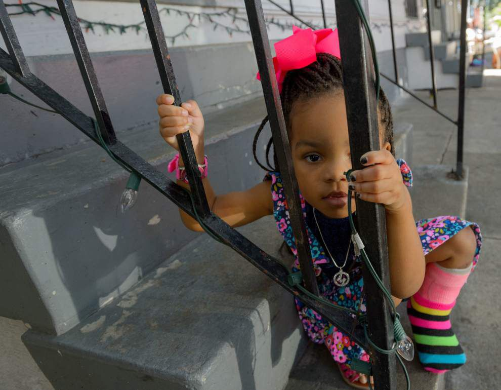 A little girl and her family try to rebuild their lives after stray bullet shattered her leg in Treme last April _lowres