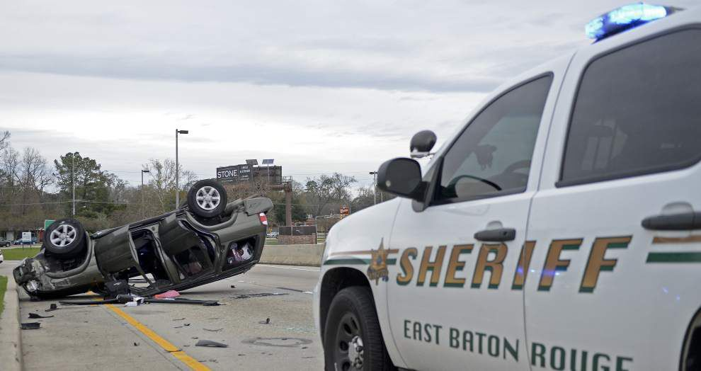 SUV fleeing police overturns on I-10 College Drive exit in Baton Rouge _lowres