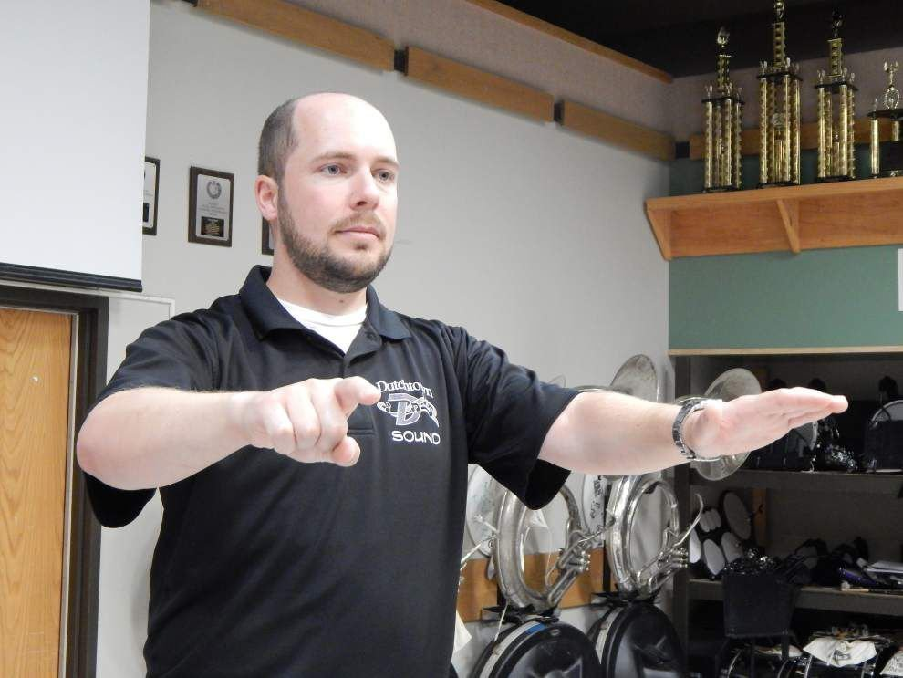 Modenbach serves as Dutchtown High School's assistant band director _lowres