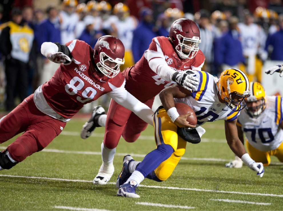 LSU drops out of the coaches' and AP Top 25 polls _lowres