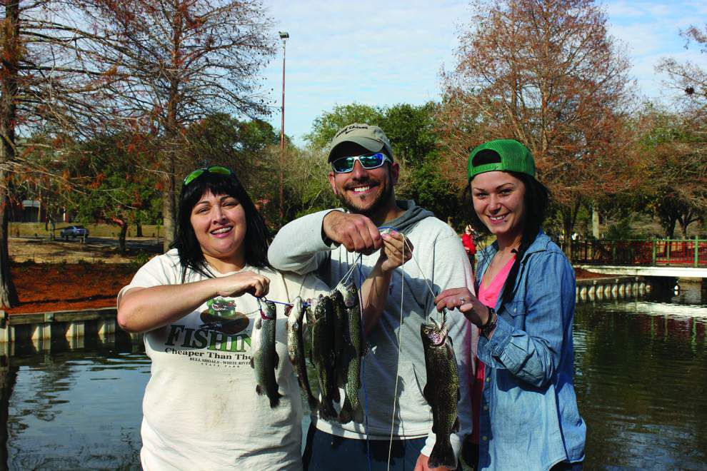 Department of Wildlife and Fisheries stocking rainbow trout in Chalmette park as part of Get Out & Fish! initiative _lowres
