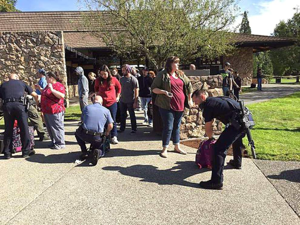 Gunman kills at least nine at Oregon college; survivor says shooter asked victims their religion before shooting _lowres