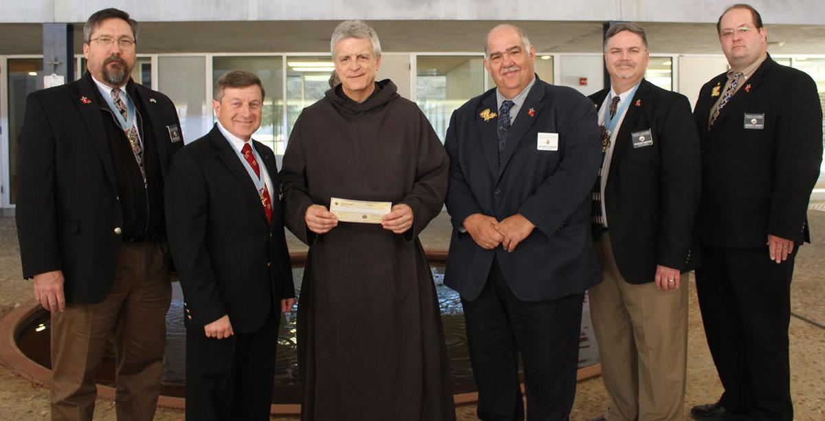 Knights of Columbus Donate to Saint Joseph Seminary College.JPG