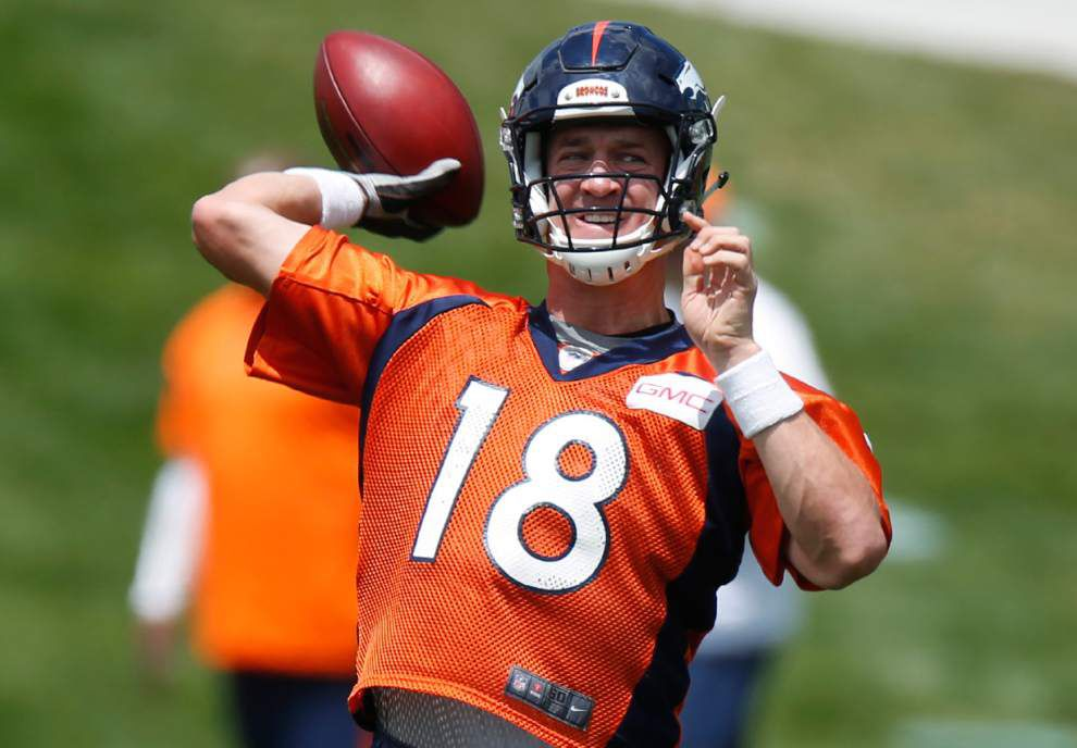 Peyton Manning adjusting to new offense in Denver _lowres
