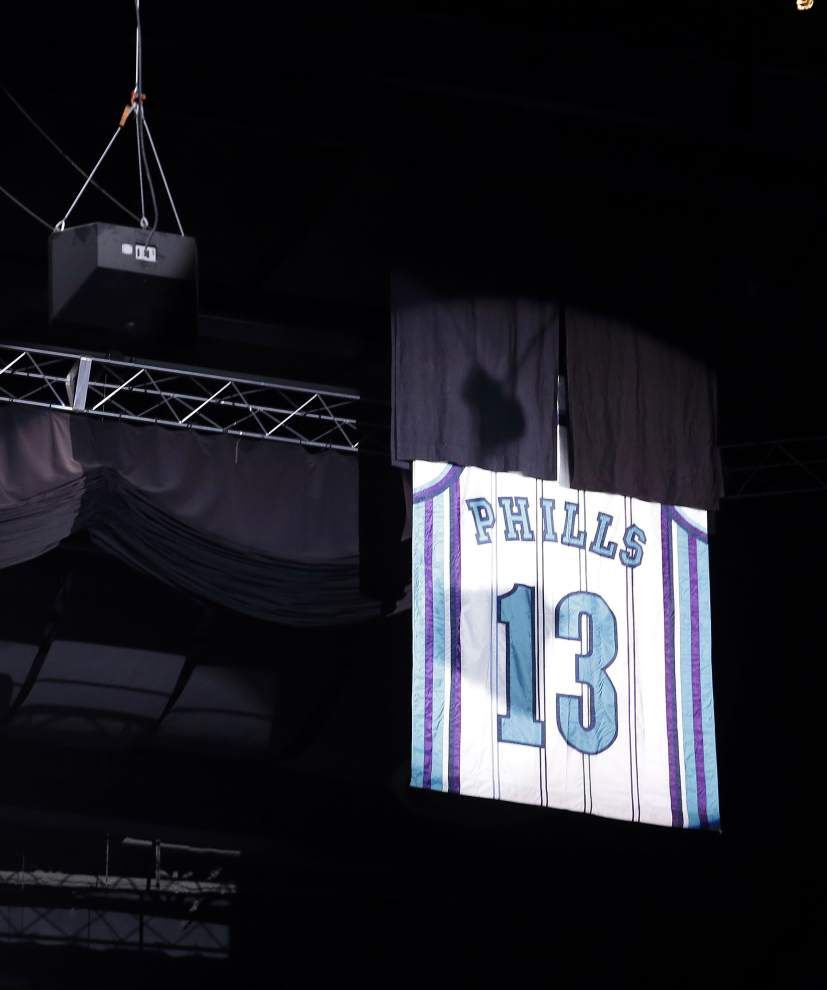 Jersey of former Southern star Bobby Phills returns to Charlotte rafters _lowres