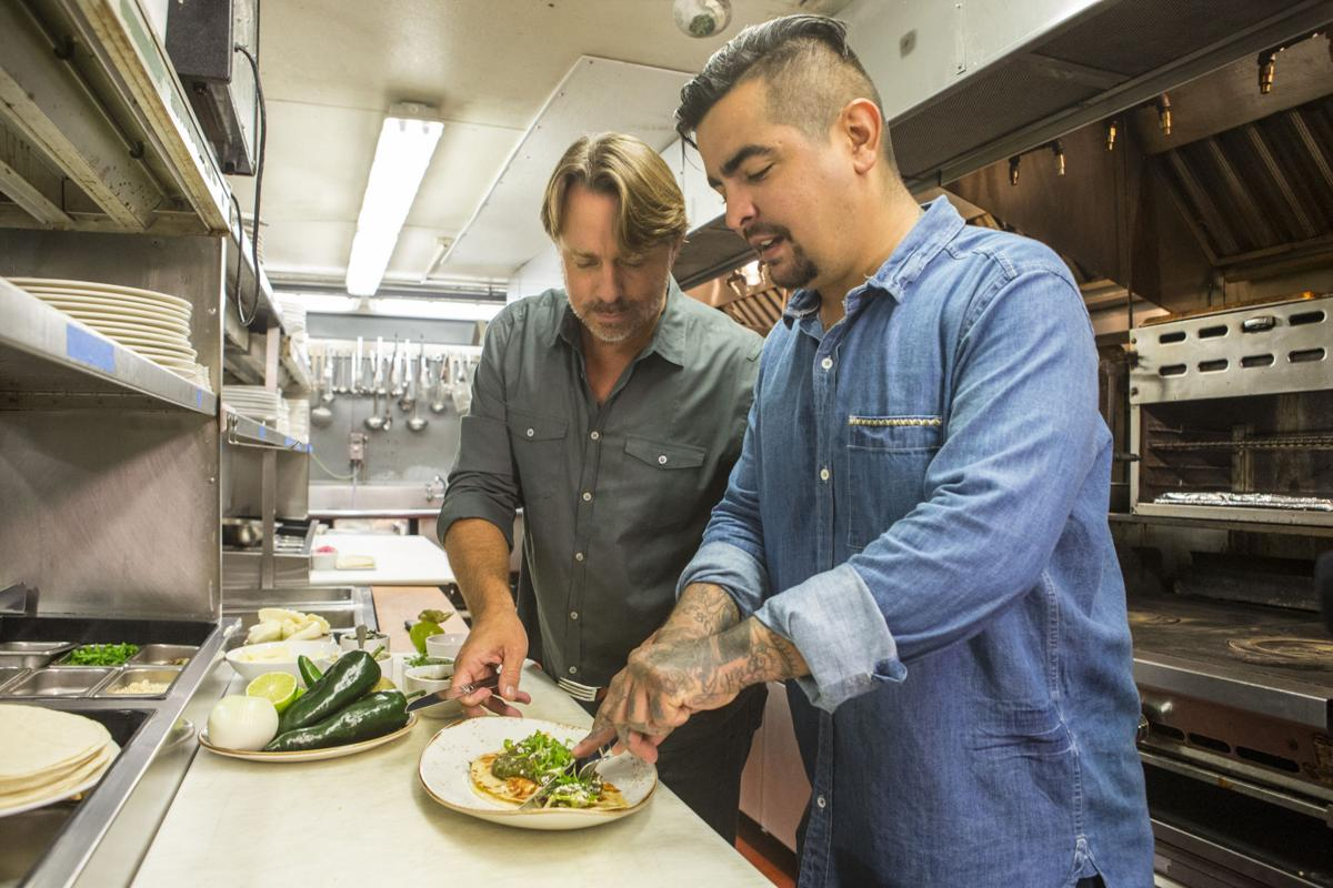 Host Aaron Sanchez and guest John Besh prepare a taco at Jo.jpg