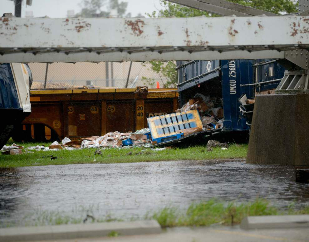 Video shows train cars blown off elevated New Orleans track by storm winds; no injuries reported _lowres