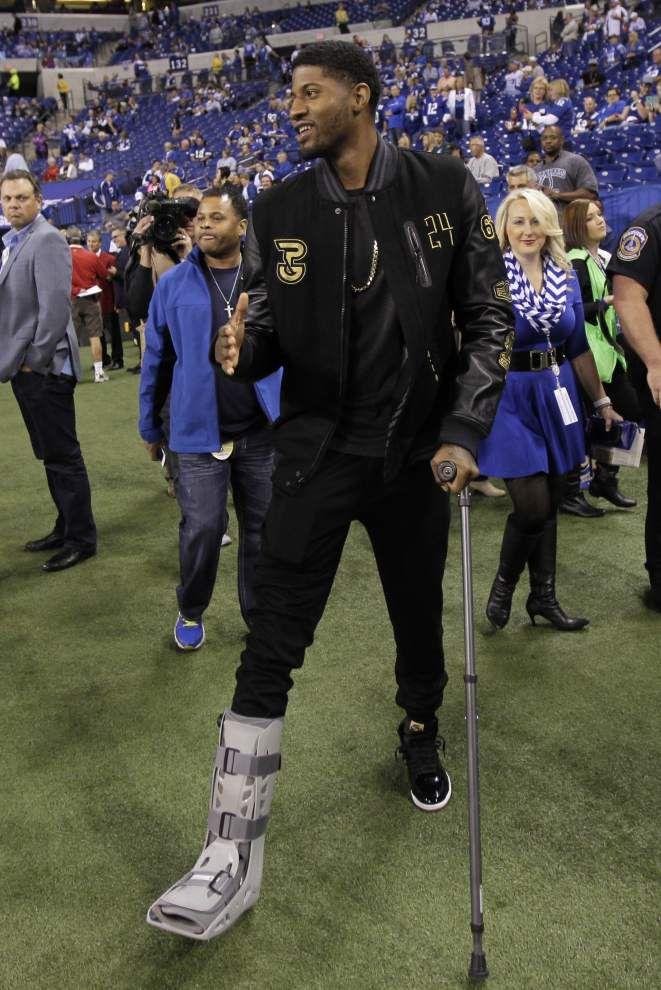 Paul George making rehab progress on broken leg _lowres