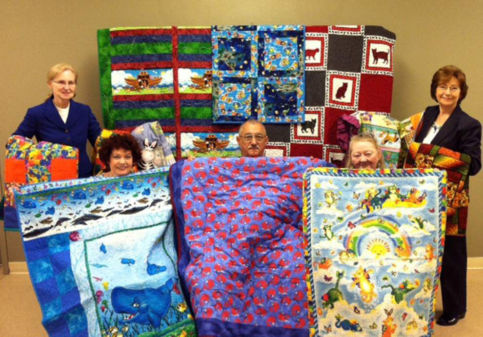 Regional quilters donate to JOY Fellowship charity auction _lowres