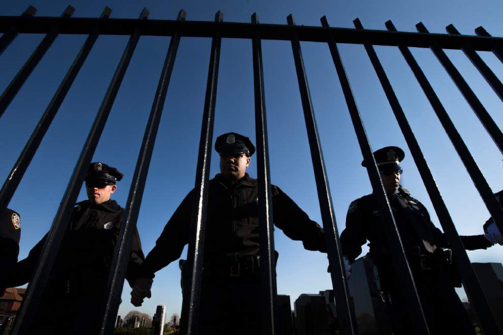 Fellow officers mourn NYPD cop at funeral _lowres