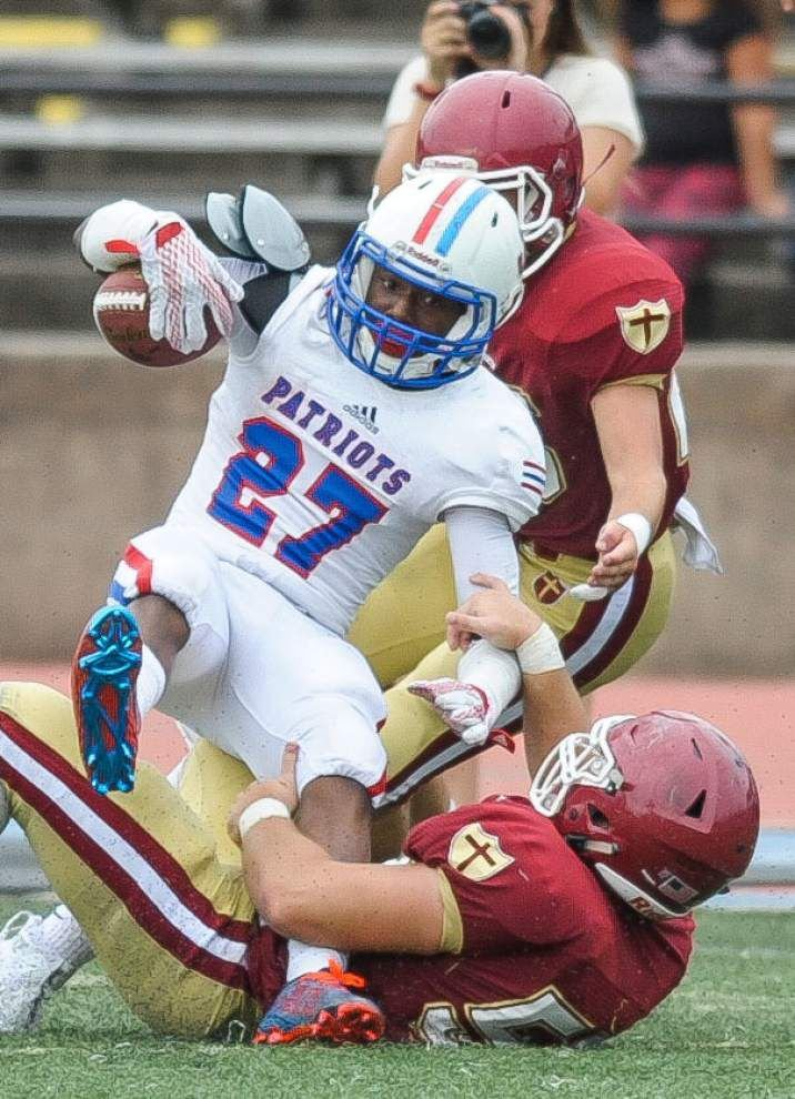 Different teams, different seasons: Much has changed for Jesuit, John Curtis after playing in 2014 state title game _lowres