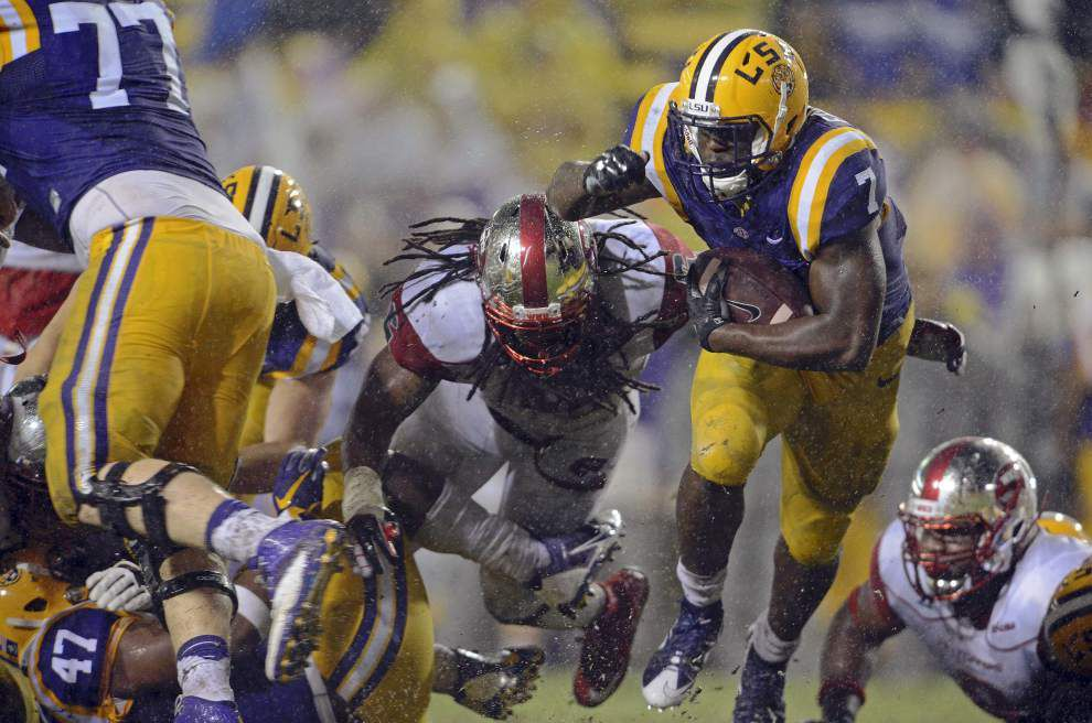 Leonard Fournette's season may be over, but his race to be NCAA rushing champion continues _lowres