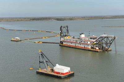 Early flooding on Mississippi brings large amount of sediment, calls for early dredging to keep shipping channels open _lowres