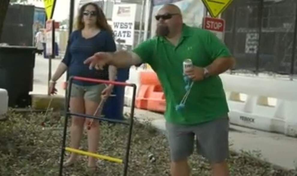 Country music fans enjoy tailgating on LSU campus _lowres
