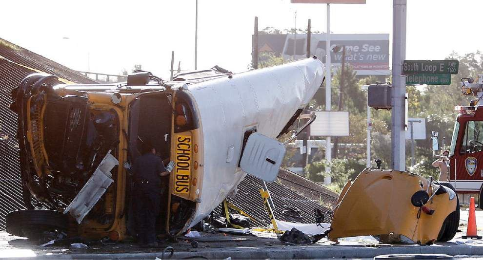 Two students dead, others injured after Houston school bus drives off overpass _lowres