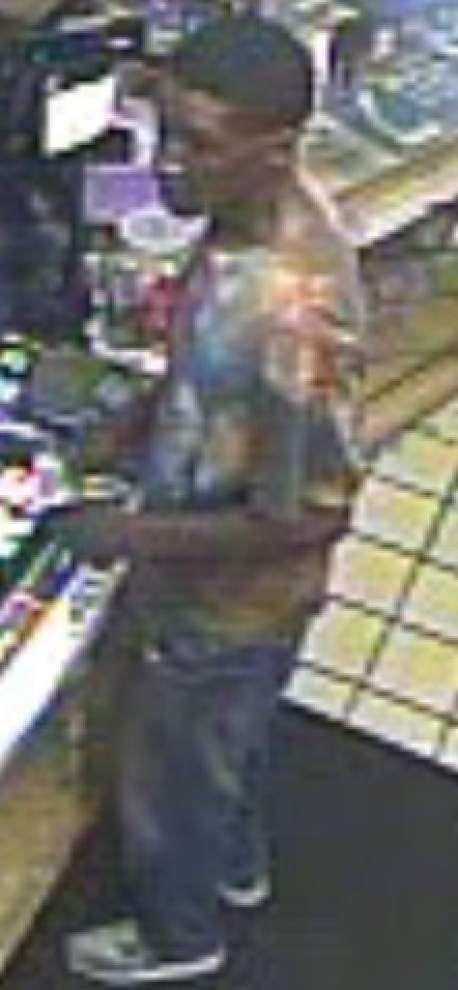 Police seek help in identifying robber of Plank Road food store _lowres
