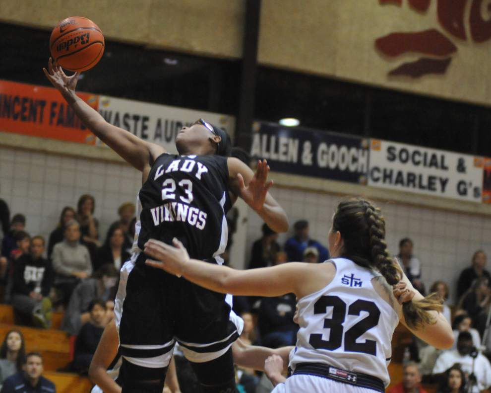 St. Thomas More teams, Lafayette Christian boys, North Central girls lead Acadiana Top 5s _lowres