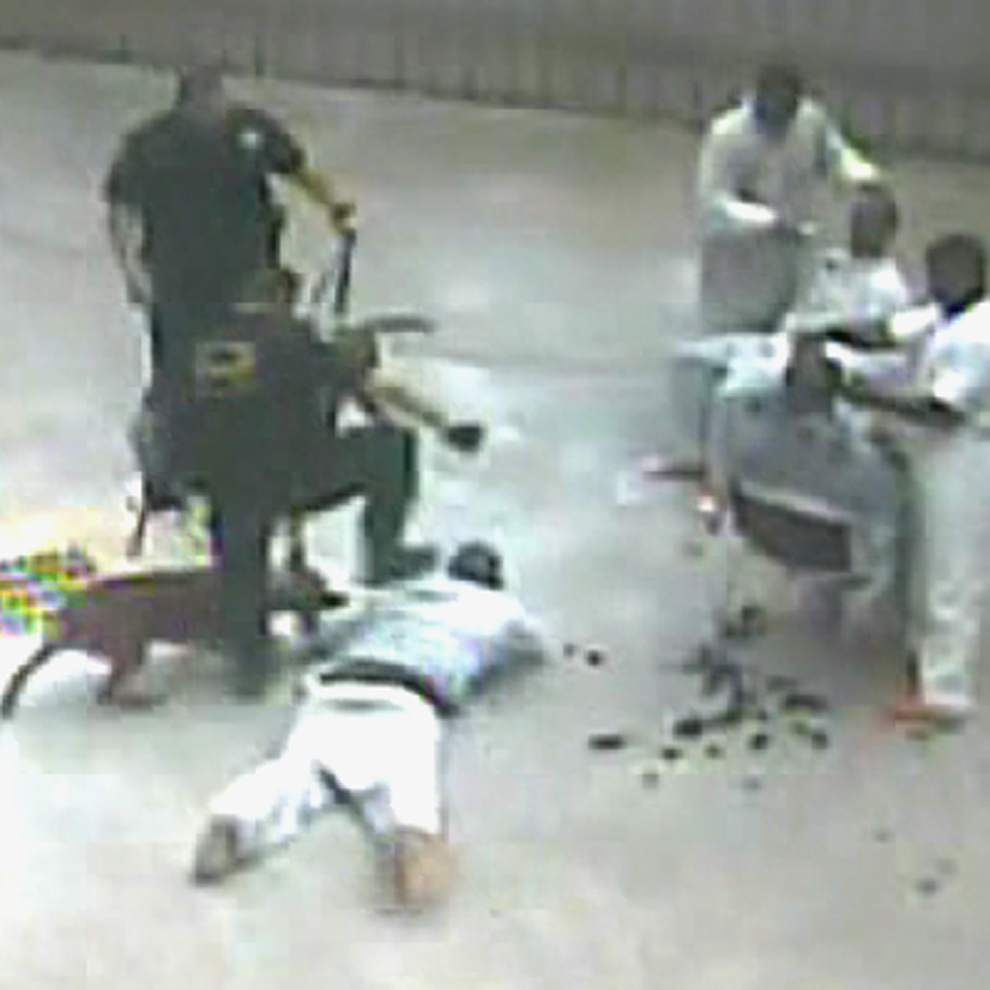 Video: Inmate thrown on ground, attacked by dog, stomped on by Iberia Parish deputy in shocking surveillance footage _lowres