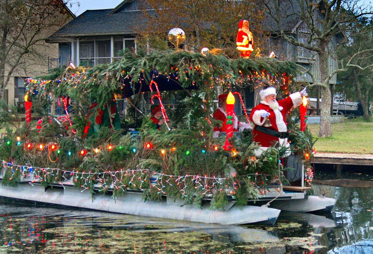 santa on the bayou floats through coin du lestin in slidell - Christmas In The Bayou