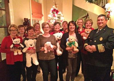 Club donates bears, books for children affected by fires _lowres