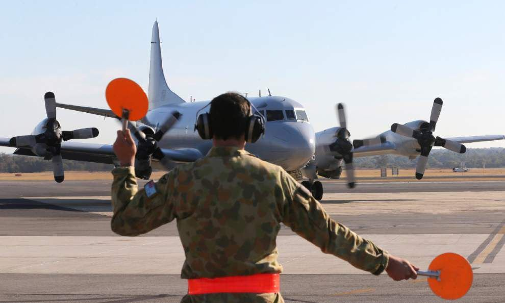 Australia says planes checking new search area _lowres