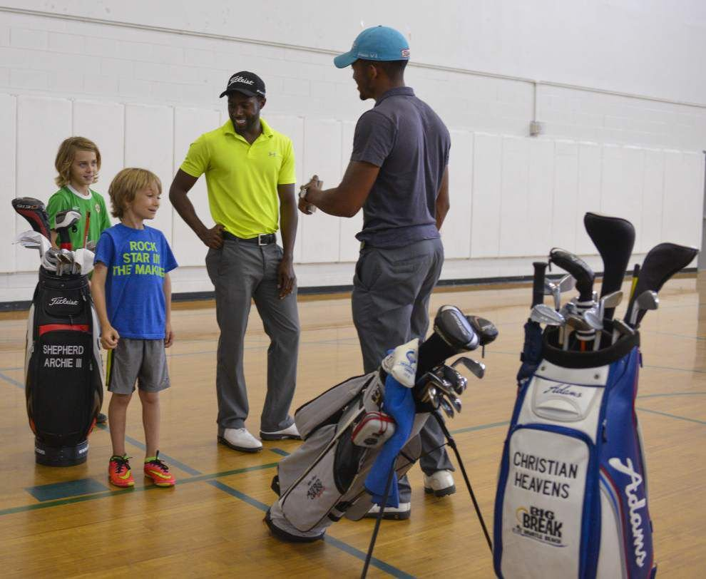 Pro golfers use First Tee event to teach youngsters about the game, life lessons _lowres