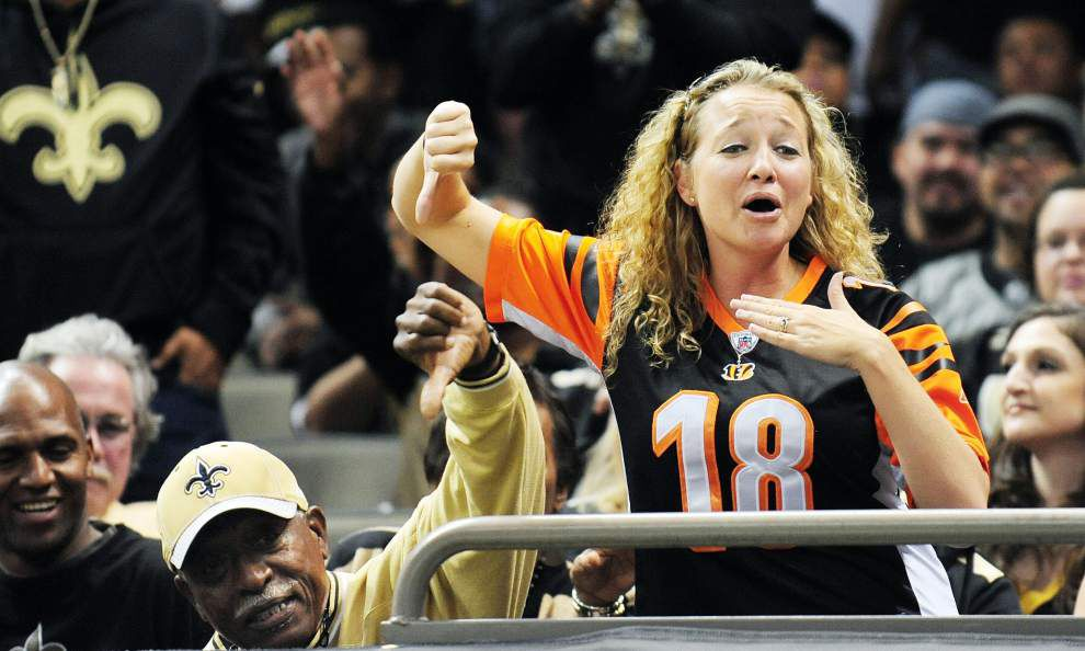 Bengals fan receives game ball after Saints fan elbows her, snatches ball player threw to her _lowres