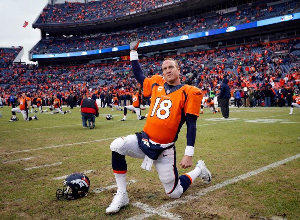 Report: Peyton Manning takes pay cut to return to Broncos _lowres