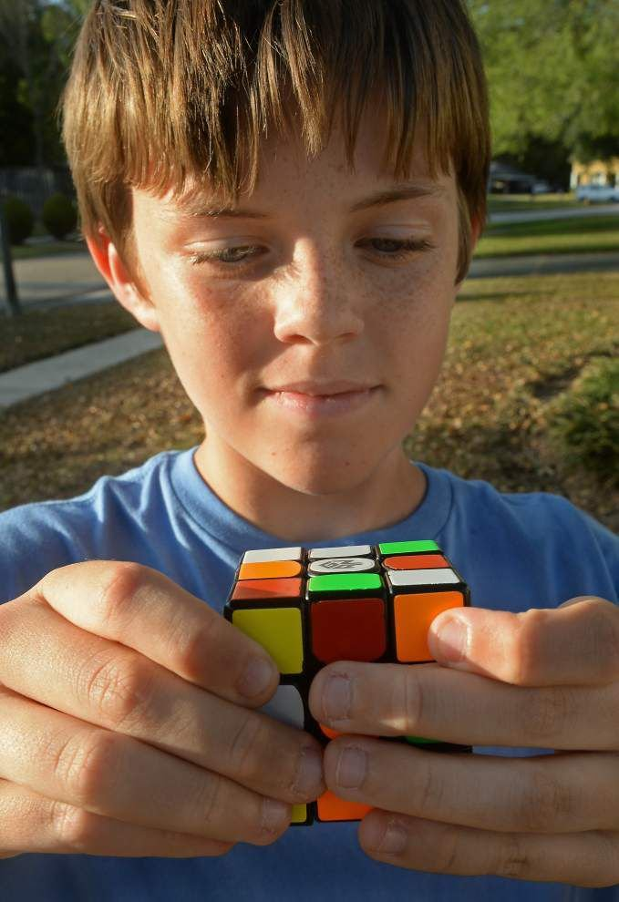Practice, practice, practice: Baton Rouge 11-year-old hopes to beat world record in Rubik's Cube _lowres