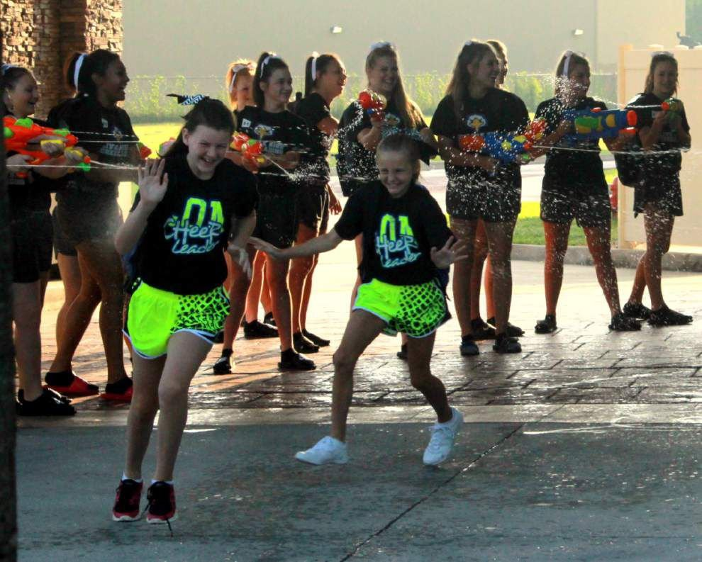Live Oak High, Middle cheerleaders attend summer event at LSU _lowres