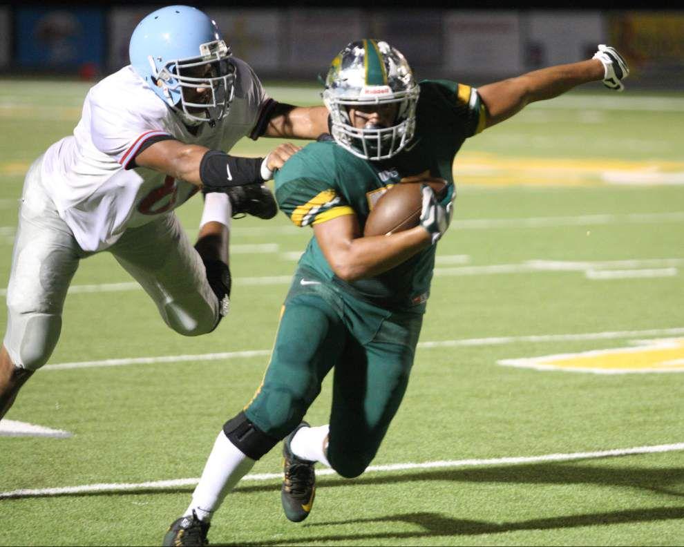 Walker, Assumption clash in battle of 4-0 teams on Wildcats' field _lowres