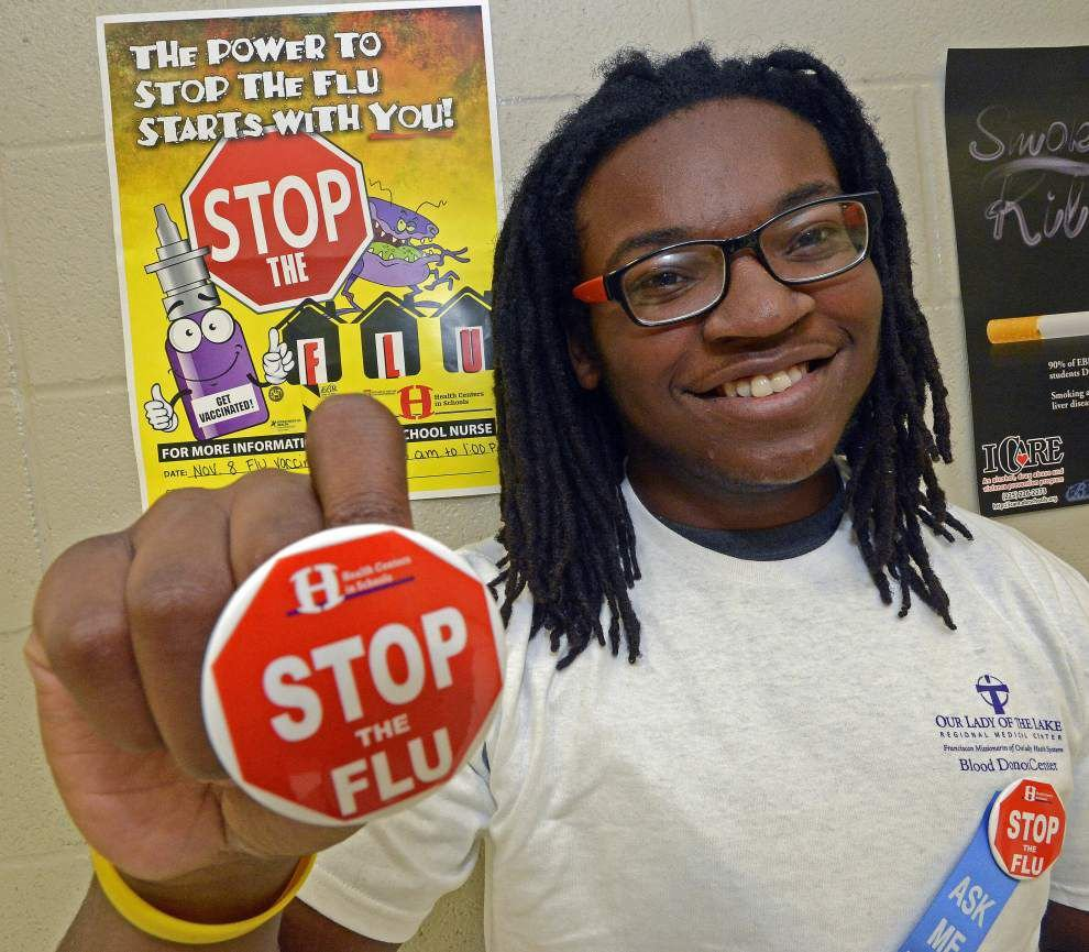 Students try to drive home the need for flu shots to their peers _lowres