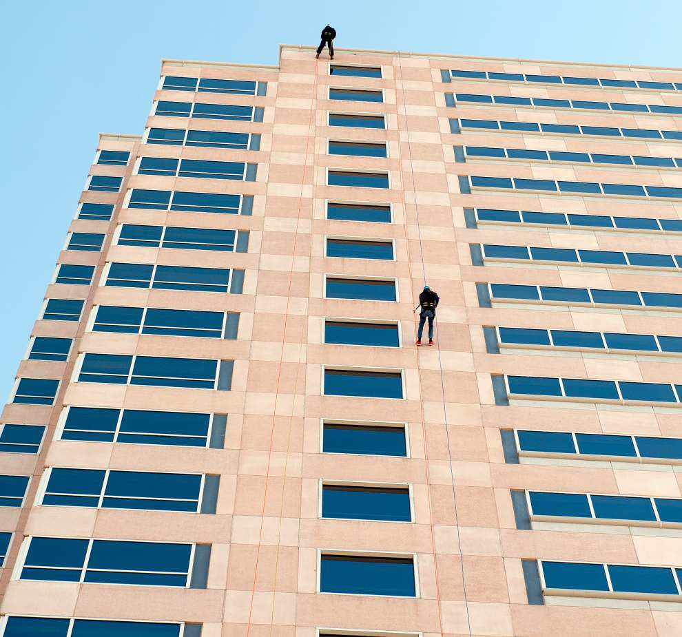 SWAT team member for a day: Fundraiser drives donors Over the Edge _lowres