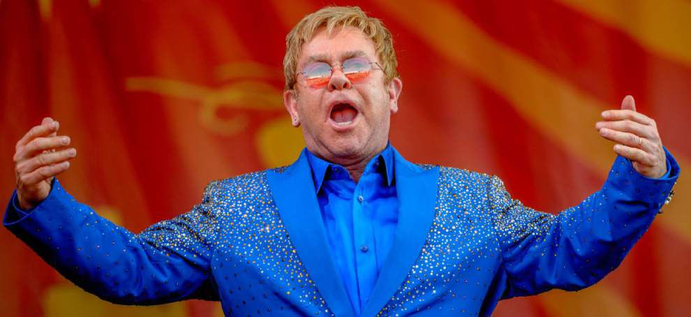 Piano legends of rock 'n' roll headline Saturday's Jazz Fest; biggest crowd to date this year for jam-packed Elton John show _lowres
